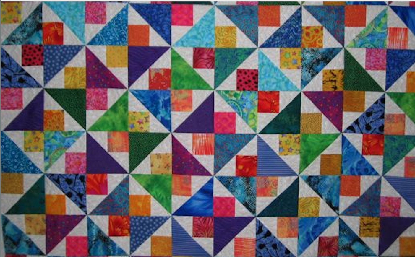 fancy half-square triangles quilt top.jpg